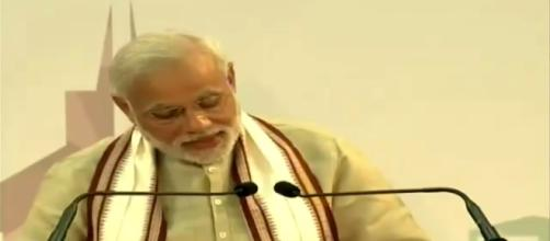 Modi addressing Indian diaspora in Abu Dhabi on Land allotted for temple- Photo credit MMF, youtube.com
