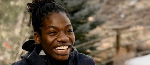 Maame Biney has more than her devoted dad at her side in her Olympic speed skating journey. [Image via Sam's Secret Collection/YouTube Screencap]