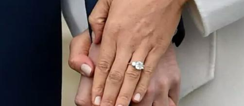 The story behind Meghan Markle's engagement ring. - [Image Credit: Emily Prince / YouTube Screenshot]