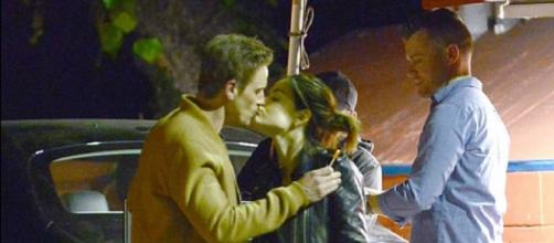 Lucy Hale and Riley Smith sharing a Valentine's kiss. (Image via Mega/Youtube screencap)