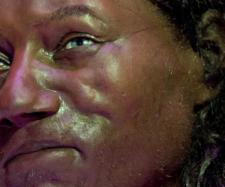 The Natural History Museum model of the Ancient Briton has dark skin and blue eyes.
