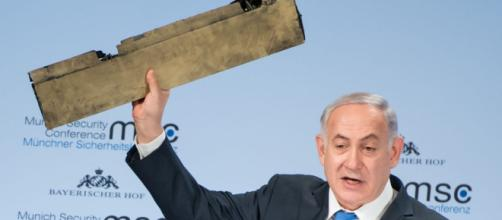 Netanyahu holds up drone piece and warns Iran: 'Do not test Israel' - sky.com