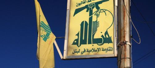Hezbollah flag in Baalbek, Lebanon (Image via yeowatzup - Wikipedia)