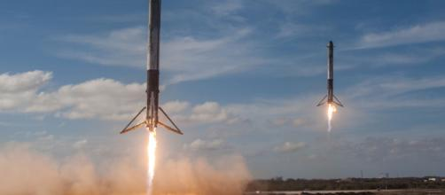 Falcon Heavy strap on boosters land [image courtesy SpaceX flickr]