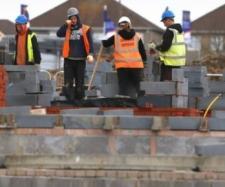 Muncitori pe un șantier de construcții în Marea Britanie