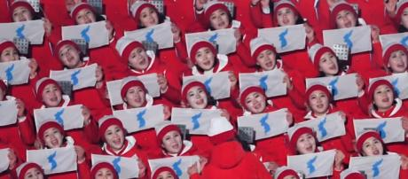 The North Korea cheerleaders have stolen the show at the Olympics. - [Image via Time / YouTube Screencap]