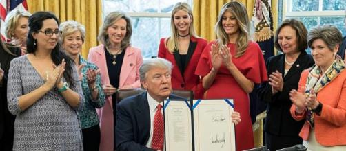 President Donald Trump in the Oval Office with Ivanka Trump and others (Image credit - Shealah Craighead, Wikimedia Commons)