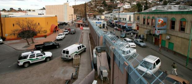 Mexican-American border at Nogales (Image credit - Gordon Hyde, Wikimedia Commons)