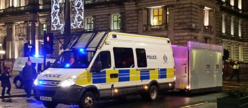 British police van guards the street. - [Image via Michel Curl - Flickr]