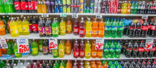 Shelf in a supermarket with products in plastic bottles (Image credit – Maksym Kozlenko/Wikimedia Commons)
