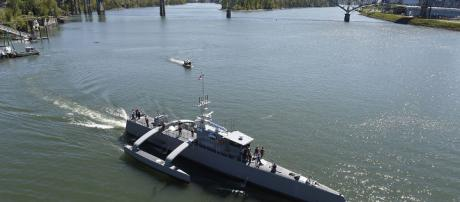 The US Navy's first unmanned ship launches from Oregon. By U.S. Navy -- photo by John F. Williams/Released [Public domain], via Wikimedia Commons