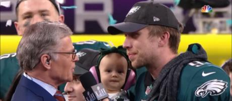 Nick Foles and his daughter accept his trophies in his Super Bowl win. - [NFL / YouTube screencap]