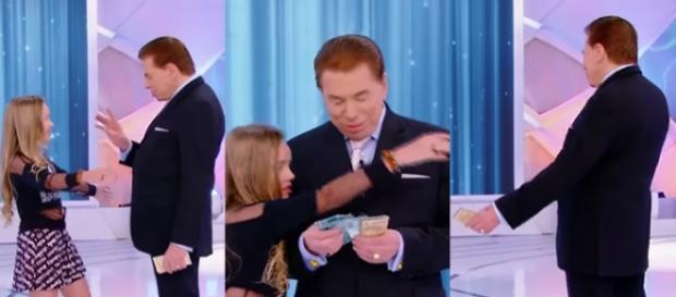 Menina tenta abraçar Silvio Santos, mas não é correspondida