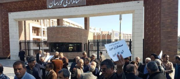 The workers are protesting in front of Khuzistan province