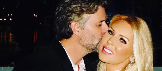 Gretchen Rossi gets a kiss from fiance Slade Smiley. [Photo via Facebook]