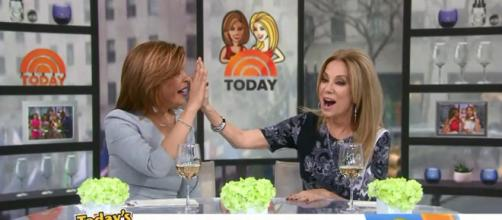 Kathie Lee Gifford shares a high-five with Hoda Kotb to celebrate the success of the song, 'Love Me to Death.' - [Today / YouTube screencap]
