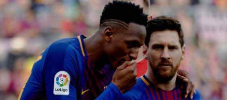 Yerry Mina e Leo Messi estão se dando muito bem no Barça. (foto reprodução).