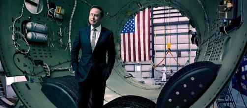 Elon Musk stands inside a rocket awaiting assembly (Image Credit: SpaceX/Wikimedia Commons)