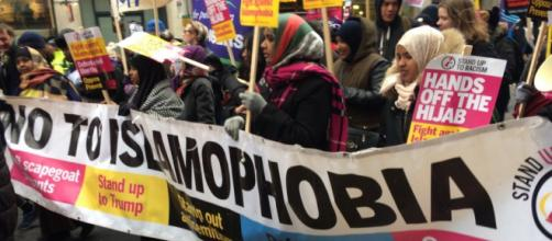 A photo from Glasgow's anti-racism march of Scottish Muslims holding a 'No To Islamophobia' Sign. Photo Credit: www.standuptoracism.org.uk
