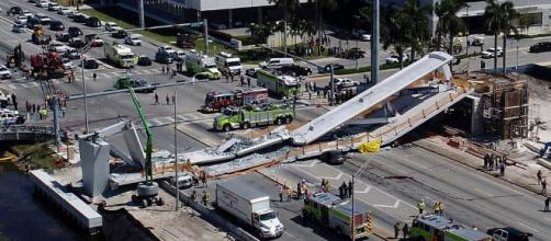 Miami pedestrian bridge collapses, killing four people, crushing ( image credit CBS-Youtube.com)