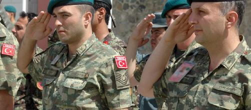 Turkish Army soldiers offer up a salute [Image via NATO Training Mission-Afghanistan - WikiMedia]