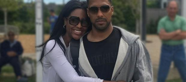 Kenya Moore poses with husband Marc Daly. [Photo via Instagram]