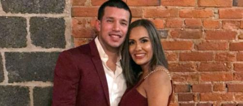 Javi Marroquin and Briana DeJesus pose in matching maroon outfits. [Photo via Instagram]