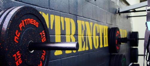 More than just weight plates, they are for self-improvement and empowerment. [Image via Maxpixel]