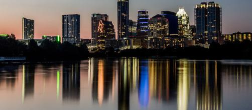 The nighttime skyline of Austin, Texas (Image via Argash - WikiMedia Commons)