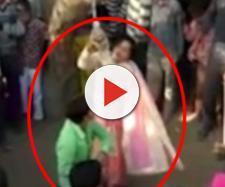 Mulher é agredida pelo esposo em público (Captura de vídeo)