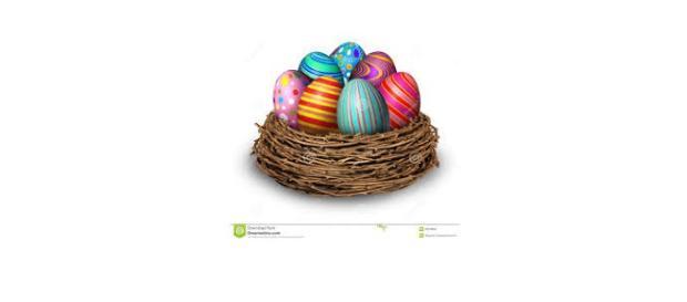 Easter eggs in a nest [image via Dreamstime.com]