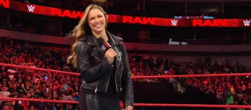 Ronda Rousey is still getting the hang of the mic work involved in pro wrestling [Image via WWE / YouTube Screencap]