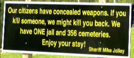 A welcome sign to Georgia's Harris County has gone viral. [image via Harris County Sheriff's Dept.]