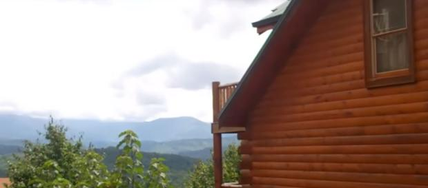 The Smoky Mountains offer a peaceful view. [image source Cabin Fever Vacations/YouTube screenshot]