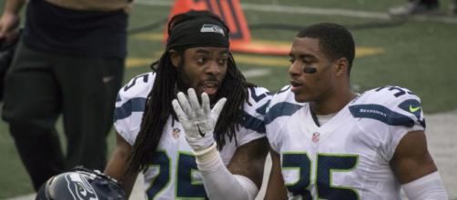 Richard Sherman (left) - Keith Allison via Flickr