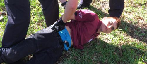 Image shows Nikolas Cruz being arrested after killing 17 students and staff -- Coconut Creek Police Department via wikimedia