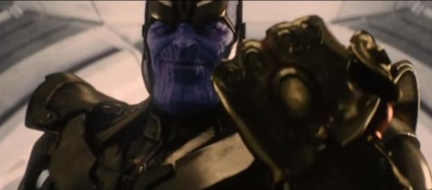 Thanos wearing his Infinity Gauntlet and preparing to get all the Infinity Stones. [Image via The Best Trailers/YouTube screencap]