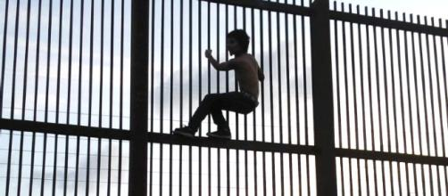 Trump wants a bigger wall because he says 'Mexicans climb better.' [Image source: Nofx221984/Wikimedia]