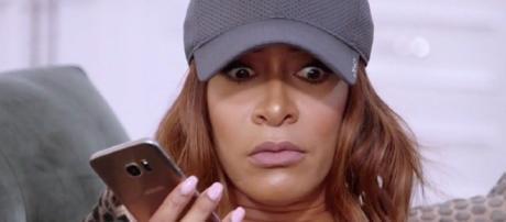 Sheree Whitfield on the phone on 'RHOA.'- [Photo via Bravo / YouTube screencap]