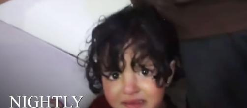 Photo of a child affected by the gas attack.- [Image credit: CNBC Nightly News / YouTube screencap]