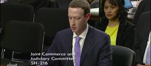 The Facebook owner faced off with American lawmakers. - [Image via CNET / YouTube screencap]