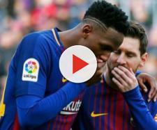 Yerry Mina com Leo Messi, no Barcelona