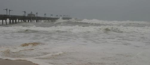 Waves crash into the pier at Panama City Beach as a hurricane approaches the Gulf Coast (Image Credit :Jacqui Barker/Wikimedia Commons)