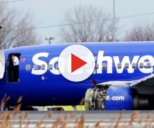 Stunned onlookers view Southwest Flight 1380. [Image via Philadelphia Inquirer/YouTube]
