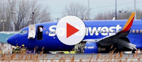 Stunned onlookers view Southwest Flight 1380. [Image via Philadelphia Inquirer/YouTube]