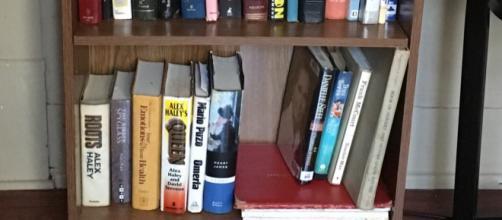 Lifehack to steady a loose shelf in a bookcase. (Image via Cheryl E. Preston/Author).