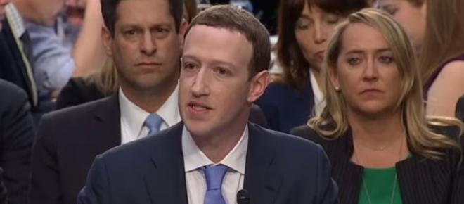 Mark Zuckerberg stands for first hearing