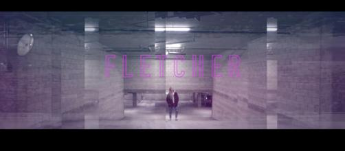 Cari Fletcher, publicly known as Fletcher, in her music video for 'Wasted Youth.' [image source: FLETCHER/YouTube]