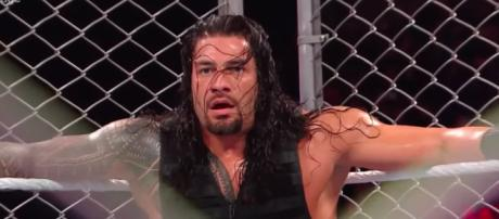 Roman Reigns will battle Brock Lesnar for the WWE Universal title inside a steel cage on Friday. [Image via WWE/YouTube]