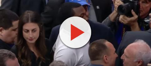 Hip-hop star Meek Mill in the crowd before Tuesday night's Philadelphia 76ers game. [Image via ESPN / YouTube screencap]